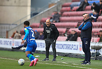 8th February 2020; DW Stadium, Wigan, Greater Manchester, Lancashire, England; English Championship Football, Wigan Athletic versus Preston North End; Preston North End manager Alex Neill and Wigan Athletic manager Paul Cook look on from the touchline