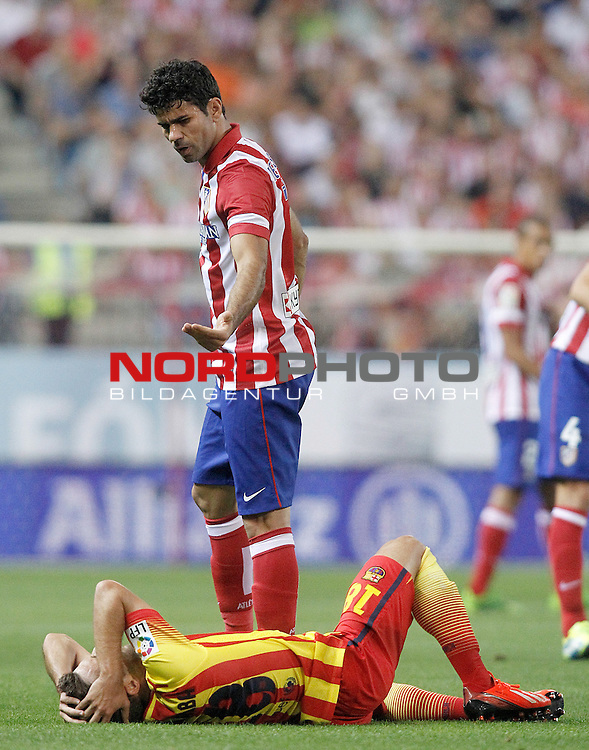 Atletico de Madrid's Diego Costa (t) and FC Barcelona's Jordi Alba during Supercup of Spain 1st match.August 21,2013. Foto © nph / Acero)