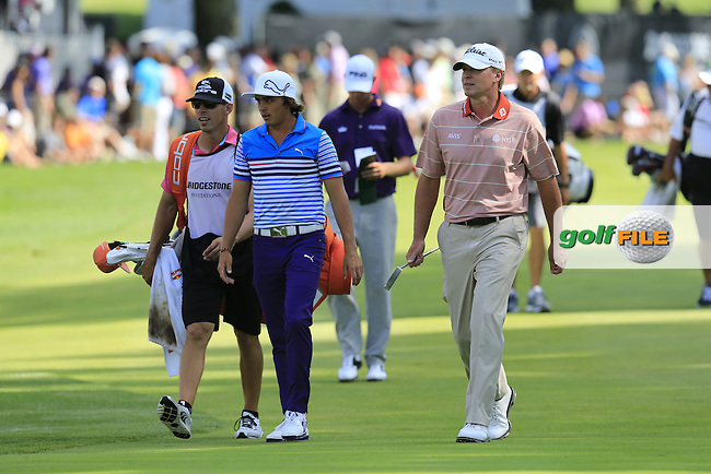 Rickie Fowler and Steve Stricker (USA) walk to the 16th green during Saturday's Round 3 of the 2013 Bridgestone Invitational WGC tournament held at the Firestone Country Club, Akron, Ohio. 3rd August 2013.<br /> Picture: Eoin Clarke www.golffile.ie