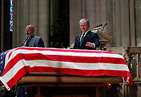Former President George W. Bush puts his hand on the flag-draped casket of former President George H.W. Bush after giving a eulogy during the State Funeral at the National Cathedral, Wednesday, Dec. 5, 2018, in Washington. <br /> CAP/MPI/RS<br /> &copy;RS/MPI/Capital Pictures
