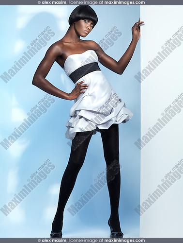 Beautiful young woman high fashion model posing in studio settings