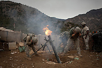 US Army Soldiers from Viper Company 126, 2nd Platoon, fire 120mm mortars in defense of an attack on Restrepo Firebase in the restive Korengal Valley. During the attack Sgt Lacie was shot in the head and medevaced.