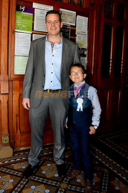 23/05/2015 – St. Peter's Communion – Evan Biggins and his father Noel.