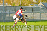 Shane McSweeney Laune Rangers feels the pain of Colm Kelly Rathmore tackle during their division 1 clash in Killorglin on Saturday