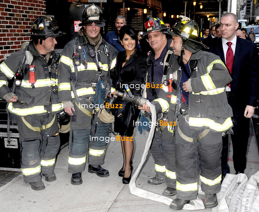 Salma Hayek at The Late Show With David Letterman in New York City, poses with the firemen in front of the studio. New York, October 10, 2012...