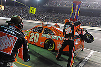 Joey Logano (#20) makes a pit stop.