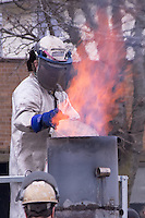 Adding scrap to make molten iron for the Winter Iron Pour in Madison.