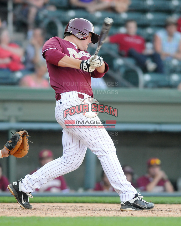 First baseman Connor Lewis (44) of the Elon College Phoenix in a game against the Clemson Tigers on March 21, 2012, at Fluor Field at the West End in Greenville, South Carolina. Clemson won 4-2. (Tom Priddy/Four Seam Images)