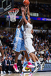 Andre Washington (31) of the Wake Forest Demon Deacons tries to shoot over Joel James (42) of the North Carolina Tar Heels during first half action at the LJVM Coliseum on January 21, 2015 in Winston-Salem, North Carolina.  The Tar Heels defeated the Demon Deacons 87-71.  (Brian Westerholt/Sports On Film)