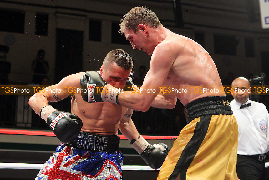 Lenny Daws (gold shorts) defeats Steve Williams in a Light-Welterweight boxing contest for the British Title at York Hall, Bethnal Green, promoted by Matchroom Sports / Barry Hearn - 09/07/10 - MANDATORY CREDIT: Gavin Ellis/TGSPHOTO - Self billing applies where appropriate - Tel: 0845 094 6026