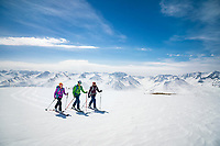 A group ski tours in the wide open landscape of the Suusamyr region of Kyrgyzstan