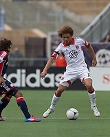 DC United midfielder Nick DeLeon (18) traps the ball. In a Major League Soccer (MLS) match, DC United defeated the New England Revolution, 2-1, at Gillette Stadium on April 14, 2012.
