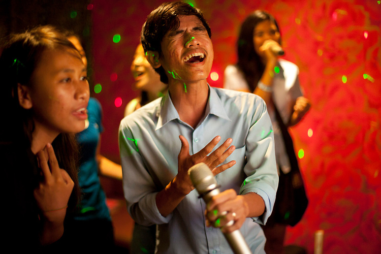 University students enjoy a night in a karaoke bar in Phnom Penh, Cambodia. <br /> <br /> Photos &copy; Dennis Drenner 2013.