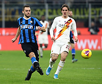 Calcio, Serie A: Inter Milano - AS Roma, Giuseppe Meazza stadium, December 6, 2019.<br /> Inter's Stefan De Vrij (l) in action with Roma's Nicolò Zaniolo (r) during the Italian Serie A football match between Inter and Roma at Giuseppe Meazza (San Siro) stadium, on December 6, 2019.<br /> UPDATE IMAGES PRESS/Isabella Bonotto