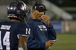 Nevada head coach Jay Norvell talks with wide receiver Dominic Christian on the sidelines against Hawaii during the second half of an NCAA college football game in Reno, Nev., Saturday, Sept. 28, 2019. (AP Photo/Tom R. Smedes)
