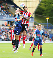 Lincoln City's Bruno Andrade vies for possession with Wycombe Wanderers' David Wheeler<br /> <br /> Photographer Andrew Vaughan/CameraSport<br /> <br /> The EFL Sky Bet League One - Wycombe Wanderers v Lincoln City - Saturday 7th September 2019 - Adams Park - Wycombe<br /> <br /> World Copyright © 2019 CameraSport. All rights reserved. 43 Linden Ave. Countesthorpe. Leicester. England. LE8 5PG - Tel: +44 (0) 116 277 4147 - admin@camerasport.com - www.camerasport.com