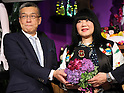 "May 4, 2016, Tokyo, Japan - American fashion designer Anna Sui (R) smiles with Japan's largest department store chain Mitsukoshi-Isetan holdings president Hiroshi Onishi as she attends the opening ceremony of her brand's special event ""Anna Sui Party"" at the Isetan department store in Tokyo on Wednesday, May 4, 2016. Isetan celebrated the 20th anniversary of Anna Sui brand's launching in Japan.  (Photo by Yoshio Tsunoda/AFLO) LWX -ytd-"