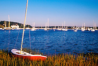 Boats in Chatham harbor with small sailboat in the foreground. Cape Cod, Massachusettes.