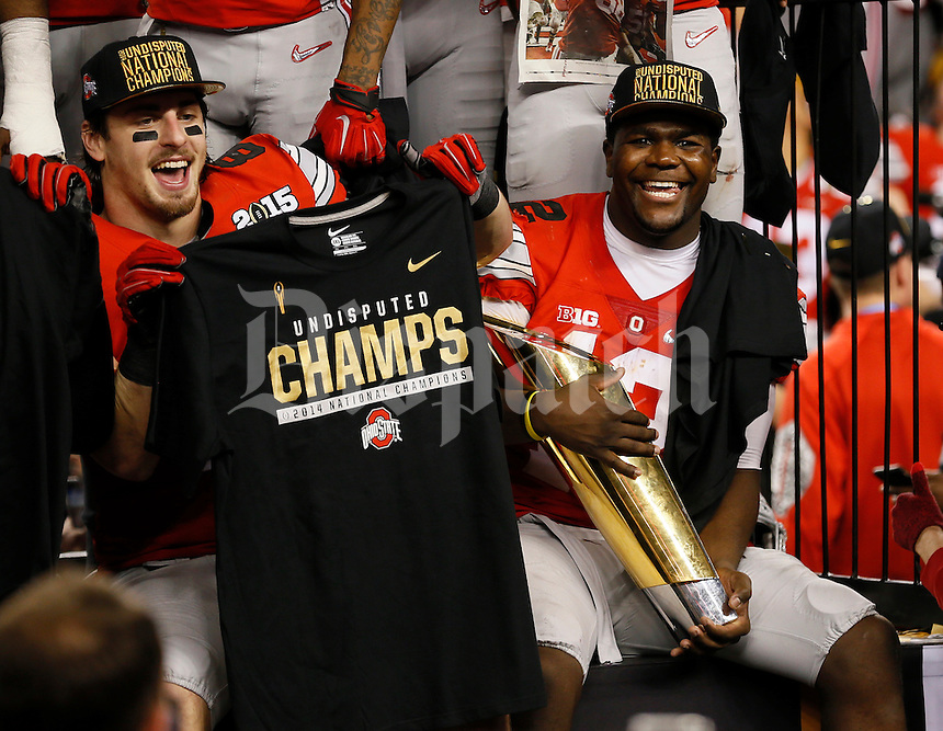 Ohio State Buckeyes quarterback Cardale Jones (12) holds the trophy beside tight end Nick Vannett (81) following their 42-20 win over Oregon in the College Football Playoff National Championship at AT&T Stadium in Arlington, Texas on Jan. 12, 2015. (Adam Cairns / The Columbus Dispatch)