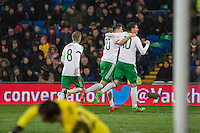 Craig Cathcart of Northern Ireland (centre) celebrates scoring his side's first goal with Steven Davis ad Kyle Lafferty during the International Friendly match between Wales and Northern Ireland at Cardiff City Stadium, Cardiff, Wales on 24 March 2016. Photo by Mark  Hawkins / PRiME Media Images.