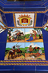 Ceramic tiles on street furniture seat scenes from Cervantes Don Quixote story, Algeciras, Spain