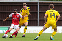 Fleetwood Town's Dean Marney clears away from Oxford United's Rob Dickie<br /> <br /> Photographer David Shipman/CameraSport<br /> <br /> The EFL Sky Bet League One - Oxford United v Fleetwood Town - Saturday August 11th 2018 - Kassam Stadium - Oxford<br /> <br /> World Copyright &copy; 2018 CameraSport. All rights reserved. 43 Linden Ave. Countesthorpe. Leicester. England. LE8 5PG - Tel: +44 (0) 116 277 4147 - admin@camerasport.com - www.camerasport.com