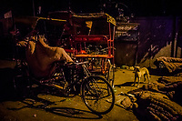 OLD DELHI, INDIA, JANUARY 12, 2016: A rickshaw driver wakes-up after having slept on his rickshaw covered by a rented blanket,  at a sleep on January 12, 2016 in Old Delhi, India. <br /> Daniel Berehulak for The New York Times