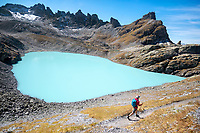 Hiking above the milky turquoise water of the Pizol 5 Lakes, Switzerland