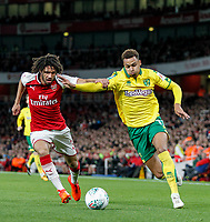 Josh Murphy of Norwich City holds off Francis Coquelin of Arsenal during the Carabao Cup match between Arsenal and Norwich City at the Emirates Stadium, London, England on 24 October 2017. Photo by Carlton Myrie.