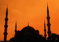 The silhouette of the dome roof and minarets of the Blue Mosque at sunset. Istanbul, Turkey.
