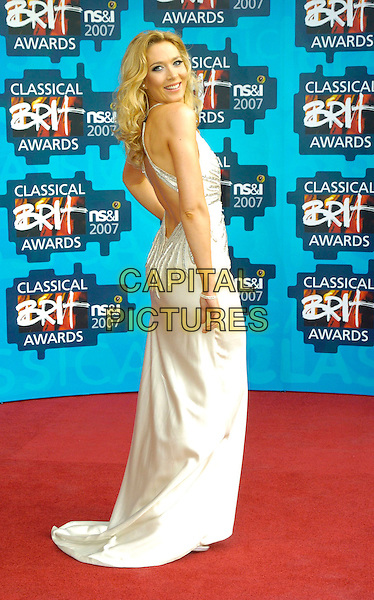 NATASHA MARSH.The Classical Brit Awards 2007, Royal Albert Hall, London, England..May 3rd, 2007.full length white dress looking over shoulder.CAP/CAN.©Can Nguyen/Capital Pictures