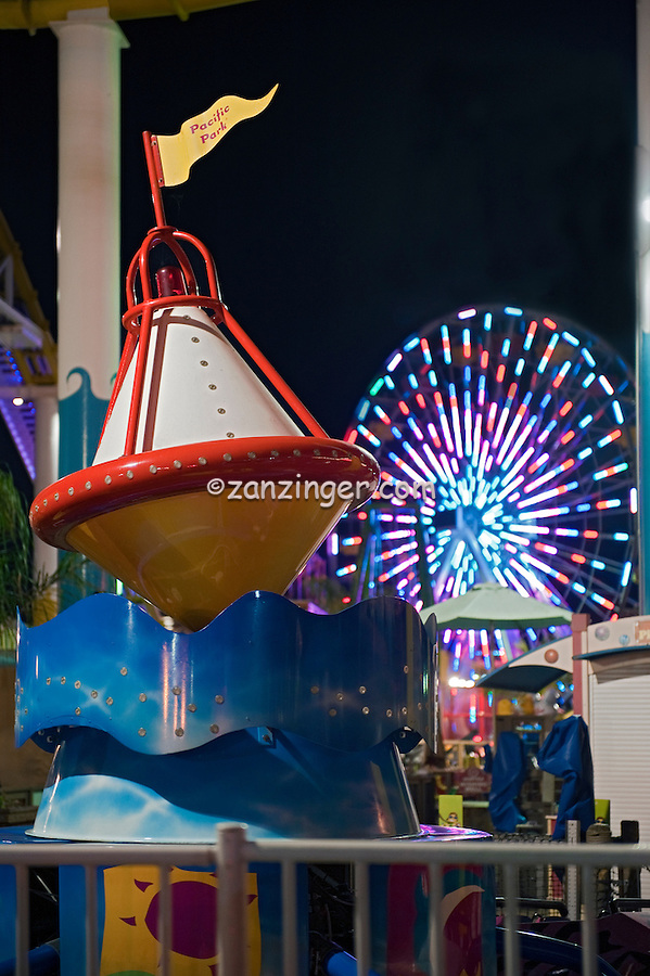 Santa Monica CA Pie, Ferris Wheel Lit at Nightl, Over Water, mix of stores, restaurants, Beautiful