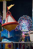 Santa Monica CA Pie, Ferris Wheel Lit at Nightl, Over Water, mix of stores, restaurants, Beautiful