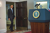 United States President Barack Obama walks to the podium to make a live statement to the nation concerning historic changes in U.S. relations with Cuba in the Cabinet Room of the White House in Washington, D.C. on Wednesday, December 17, 2014.  In his remarks the President announced he planned to start talks with Cuba to normalize ties and open an embassy as a result of the release of Alan Gross. <br /> Credit: Doug Mills / Pool via CNP