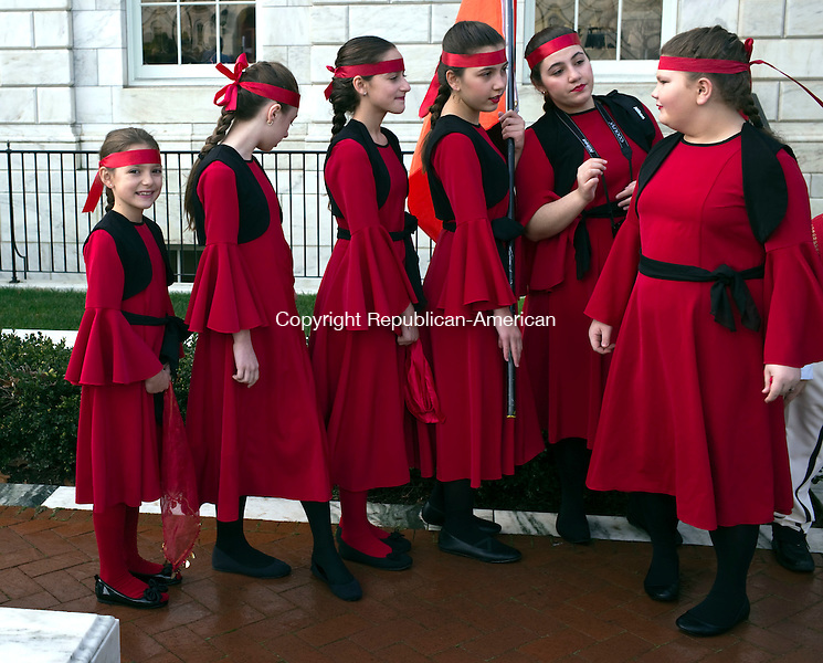 Waterbury, CT- 27 November 2015-112715CM01-  Members from the Albanian American Community Center's Hasan Prishtina, including Shefkije Dani, 16 Middlebury, second from right and Leonora Ajdari 12, of Waterbury, far right, get ready before the  annual Albanian Mayor for the Day ceremony at the Waterbury City Hall on Friday. The ceremony honored Xhemal Dani, who was born in Dollogozhda, Macedonia and migrated to Waterbury in 1999. Dani is an active member of the Albanian American Cultural Islamic Center Hasan Prishtina, and has helped develop new programs for youth including schools in Albanian language and dance. Dani also helped organize the Labor Day Weekend Albanian Festival.     Christopher Massa Republican-American