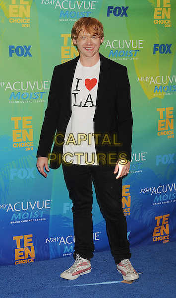 Rupert Grint.in the Press Room at the 2011 Teen Choice Awards held at the Gibson Amphitheatre in Universal City, California, August 7th, 2011..full length black suit white I heart LA t-shirt trainers .CAP/ROT/TM.©TM/Roth Stock/Capital Pictures
