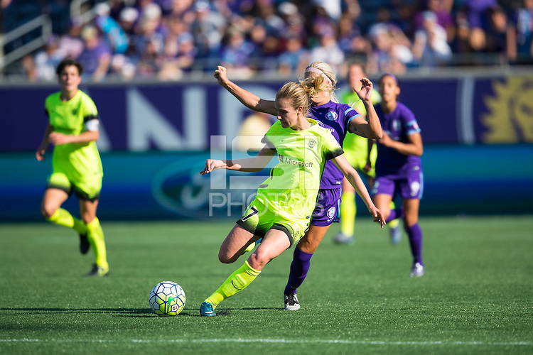 Orlando, Florida - Sunday, May 8, 2016: Seattle Reign FC forward Beverly Yanez (17) plays the ball away from Orlando Pride midfielder Kaylyn Kyle (6) during a National Women's Soccer League match between Orlando Pride and Seattle Reign FC at Camping World Stadium.