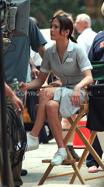 "Jennifer Lopez and Ralph Fiennes pictured on the set of ""The Chambermaid"" on Park Avenue at 49th Street in New York. July 20, 2002. Please byline: Alecsey Boldeskul/NY Photo Press.   ..*PAY-PER-USE*      ....NY Photo Press:  ..phone (646) 267-6913;   ..e-mail: info@nyphotopress.com"