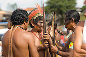 Altamira, Brazil. Kayapo Indian warriors discussing.