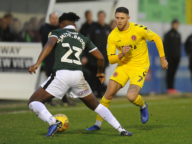 Fleetwood Town's Wes Burns takes on Plymouth Argyle's Ashley Smith-Brown<br /> <br /> Photographer Kevin Barnes/CameraSport<br /> <br /> The EFL Sky Bet League One - Plymouth Argyle v Fleetwood Town - Saturday 24th November 2018 - Home Park - Plymouth<br /> <br /> World Copyright © 2018 CameraSport. All rights reserved. 43 Linden Ave. Countesthorpe. Leicester. England. LE8 5PG - Tel: +44 (0) 116 277 4147 - admin@camerasport.com - www.camerasport.com