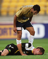 Adam D'Apuzzo stand over Shane Smeltz after the Phoenix striker had been fouled during the A-League match between Wellington Phoenix and Newcastle Jets at Westpac Stadium, Wellington, New Zealand on Sunday, 4 January 2009. Photo: Dave Lintott / lintottphoto.co.nz