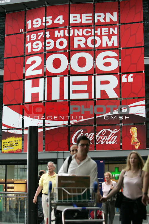 FIFA WM 2006 Germany - Feature<br /> People walking in front of a placate (1954 Bern, 1974 M&cedil;nchen, 1990 Rom 2006 hier) at the central station in Berlin during the world cup in Berlin.<br /> Foto &copy; nordphoto