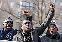 """Etwa 200 Menschen beteiligten sich am Samstag den 27. Februar 2016 zum Jahrestag der sog. """"Berliner Afrika-Konferenz"""" an einem Gedenkmarsch in Erinnerung an die Opfer des Kolonialismus, des Sklavenhandels und der Ausbeutung Afrkias durch die Europaeischen Staaten. Sie forderten die Beendigung der Besetzung der Westsahara durch Marokko und ein Ende der Sklaverei in Mauretanien, wo nach unabhaengigen Angaben noch ca. 20 Prozent der Bevoelkerung versklavt sind.<br /> Im Bild: Veranstaltungsteilnehmer singen die Suedafrikanische Nationalhymne.<br /> 27.2.2016, Berlin<br /> Copyright: Christian-Ditsch.de<br /> [Inhaltsveraendernde Manipulation des Fotos nur nach ausdruecklicher Genehmigung des Fotografen. Vereinbarungen ueber Abtretung von Persoenlichkeitsrechten/Model Release der abgebildeten Person/Personen liegen nicht vor. NO MODEL RELEASE! Nur fuer Redaktionelle Zwecke. Don't publish without copyright Christian-Ditsch.de, Veroeffentlichung nur mit Fotografennennung, sowie gegen Honorar, MwSt. und Beleg. Konto: I N G - D i B a, IBAN DE58500105175400192269, BIC INGDDEFFXXX, Kontakt: post@christian-ditsch.de<br /> Bei der Bearbeitung der Dateiinformationen darf die Urheberkennzeichnung in den EXIF- und  IPTC-Daten nicht entfernt werden, diese sind in digitalen Medien nach §95c UrhG rechtlich geschuetzt. Der Urhebervermerk wird gemaess §13 UrhG verlangt.]"""