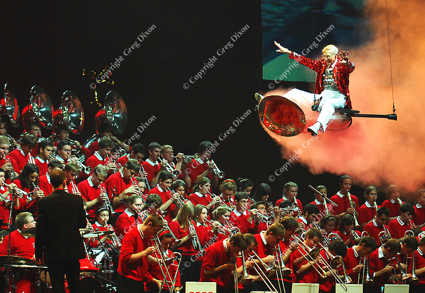 Band director Michael Leckrone flies in on a smoking tuba during Thursday's performance at the Kohl Center