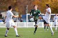 Daniel Keat (21) of the Dartmouth Big Green and Max Hamilton (7) of the Monmouth Hawks go for the ball. Dartmouth defeated Monmouth 4-0 during the first round of the 2010 NCAA Division 1 Men's Soccer Championship on the Great Lawn of Monmouth University in West Long Branch, NJ, on November 18, 2010.