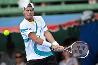 MELBOURNE, 12 JANUARY - Lleyton Hewitt (AUS) plays a backhand during his match against Mikhail Youzhny (RUS) on day one of the 2011 AAMI Classic at Kooyong Tennis Club in Melbourne, Australia. (Photo Sydney Low / syd-low.com)