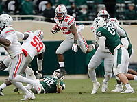 Ohio State Buckeyes running back Mike Weber Jr. (25) leaps over Michigan State Spartans linebacker Jon Reschke (28) during the fourth quarter of the NCAA football game at Spartan Stadium in East Lansing, Mich. on Nov. 10, 2018. Ohio State won 26-6. [Adam Cairns/Dispatch]