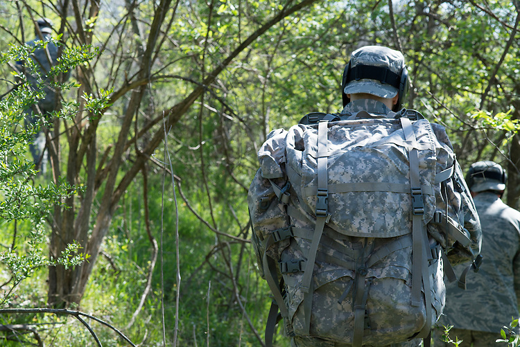 The blue team marches through the woods to the third and final checkpoint of their mobile exercise on April 16, 2016. Photo by Ohio University / Kaitlynn Stone