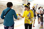 "A visitor receives Pikachu souveniers at the ""1000 Pikachu Outbreak! at Yokohama Minatomirai"" on August 09, 2014. 1000 Pikachu performed at different areas of Minatomirai in Yokohama during the summer vacation event from August 9 to 17.  (Photo by Rodrigo Reyes Marin/AFLO)"