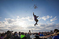 Candy is tossed by the person in the blanket toss during the Nalukataq (whale harvest festival) in the native community of Utqiagvik (formerly Barrow), in Arctic Alaska.